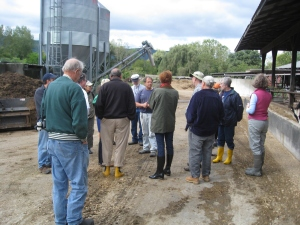 Matt Freund (facing camera) gives Master Composters a tour of his dairy farm and cow pot operation