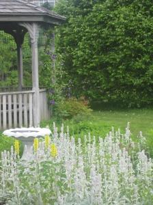Birdbath in perennial garden
