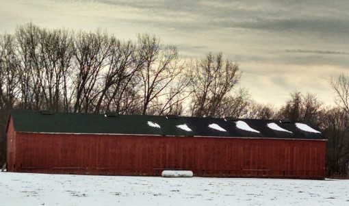 A beautiful red barn in the snow