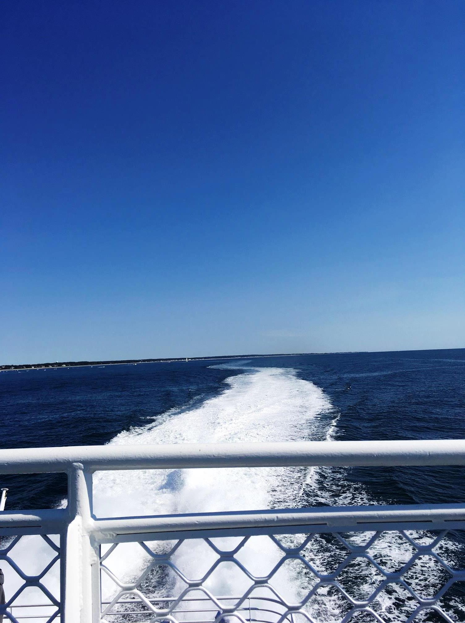 boat wake trail in ocean
