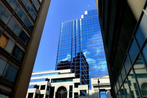 Blue glass skyscraper behind the Mechanics Savings Bank in downtown Hartford -Copyright Pamm Cooper 2013